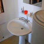 Sink in bathroom 2 - note the hot water tank!