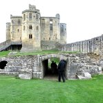 Warkworth castle keep with unfinished chapel in foreground