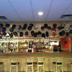 """Hat """"Wall of Shame""""  Caps and Hats lost to Ed in pool"""