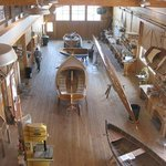 Boat building shop with projects under way