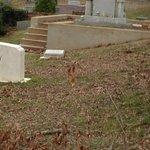 People leave bottles of bourbon on Faulkner's gravestone.