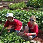 Two young volunteers in our Plant-A-Row for the Hungry Garden