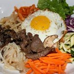 Bibimpap. Mixed vegetables with bulgogi (marinated sliced ribeye) with a sunny side egg on top.