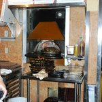 Coal Fired Oven Cooks The Pizza
