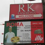 Beach Rd has signs to RK Fashions, Patong, Thailand