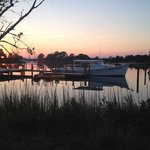 "Sunset over the ""Helen Elizabeth"" moored at the Inn at Tabbs Creek"
