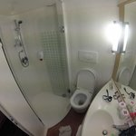 Small, but clean and efficient bathroom with very basic amenities