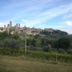 View of San Gimignano walking from farmhouse