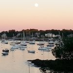 Full moon rising over Marblehead at sunset