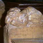 Carved camel as a pew end
