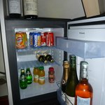 small fridge in large bedroom