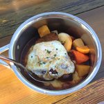 Slow cooked pork with fried egg. Served in the pot.
