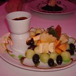 Chocolate fondue with fruit for dipping