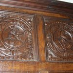 The paneling on the walls of the dining room,