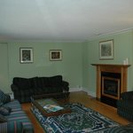 Cozy Living Room with Fireplace at Classy Country Bourget Inn & Spa