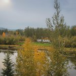 view across river to Love Alaska sign