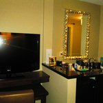 Vanity area and TV in adjoining suite