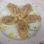 special crab salad on white bean paste over fresh crustini