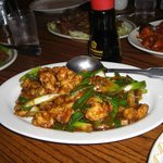 Prawns with ginger and scallions.