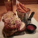 meatloaf headwich with sweet potato fries.