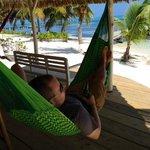 Lounging at the bar hammock with a Belikin beer.