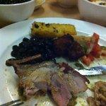 The pork is amazing. Polenta chips, black beans, salsa, fried banana