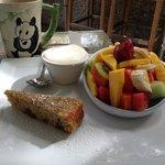Fresh fruit, granola, yogart and muffin