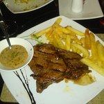 Ribeye, chips, peppercorn sauce, garlic bread