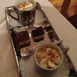 Amuse Bouche for two. A creamy fish soup with coco powered and truffle shavings served in a tiny