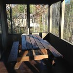 Screened in porch with picnic table