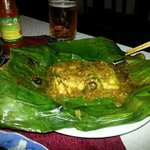 House specialty.... Fish cooked in banana leaf with lemongrass and rum