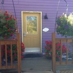 Front entry with beautiful geraniums