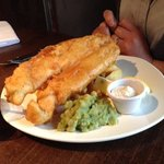 Battered haddock with chunky chips and mushy peas.