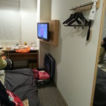 Flat screen TV with limited channels & desk with cable socket & a large foldeable vanity mirror