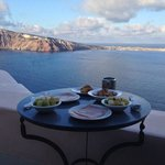 nreakfast on the terrace overlooking the caldera
