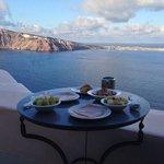 nreakfast on the terrace overlooking the caldera