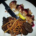 flat iron steak with stuffed shrimp and blueberry sauce
