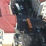 zoom down the street people getting in bus