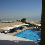 Image from our hotel room of pool and Dead Sea