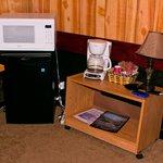 microwave and mini fridge and leaning bookshelf