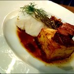 Poached cod with smoked pork, chanterelles and dill gravy.
