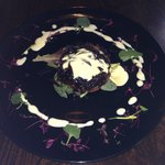 sweet red onion tart with goats cheese sauce