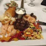 Tenderloin smothered with shrimp in garlic sauce and Boston Baked Potato- Delish!