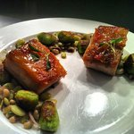 Bourbon-Pepper Jelly Glazed Pork Belly with Arugula Gnocchi, Field Beans and Peas