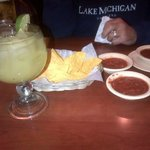sour mix margarita, cold chips with bland salsa