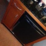 The fridge/microwave/coffee station
