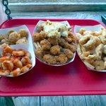 Shrimp, scallops, alligator, frog legs, conch, and fish