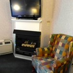 Kitchenette room with air conditioning, flat screen tv, dvd player, fireplace.