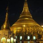 Shwedagon Pagoda magnificently floodlit at night.