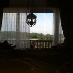 View of golf course while lying in bed